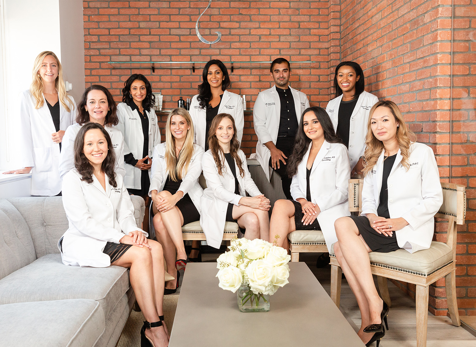 Group photo of Board Certified Dermatologists at Spring Street Dermatology, New York City, NY.