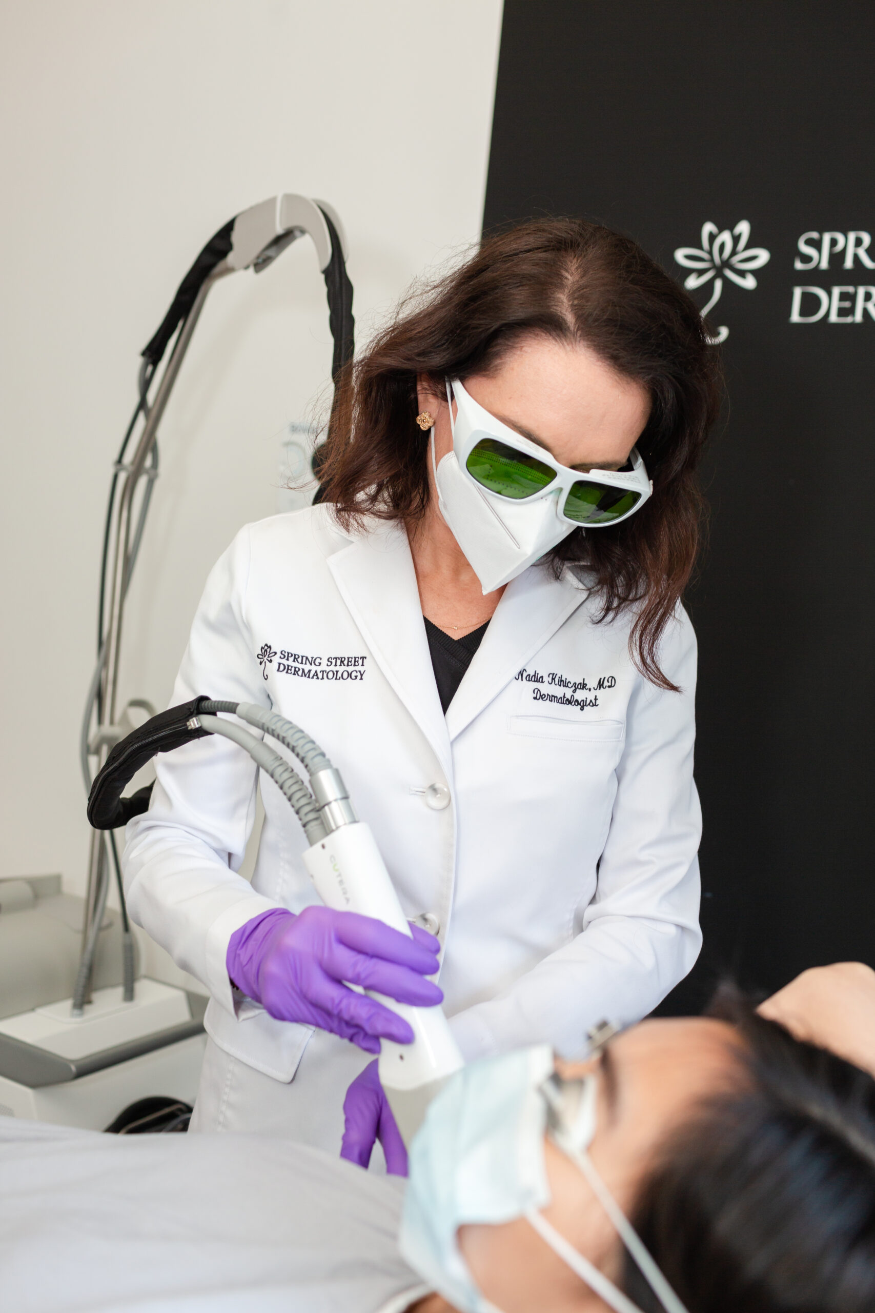 Dr. Nadia Khicizak is performing a treatment on her patient at Spring Street Dermatology in NYC, NY.