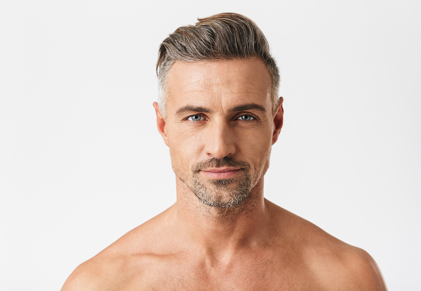 Image of a middle aged male model with youthful face and skin, which can be achieved with Medical Dermatology treatments at Spring Street Dermatology in New York City, NY.