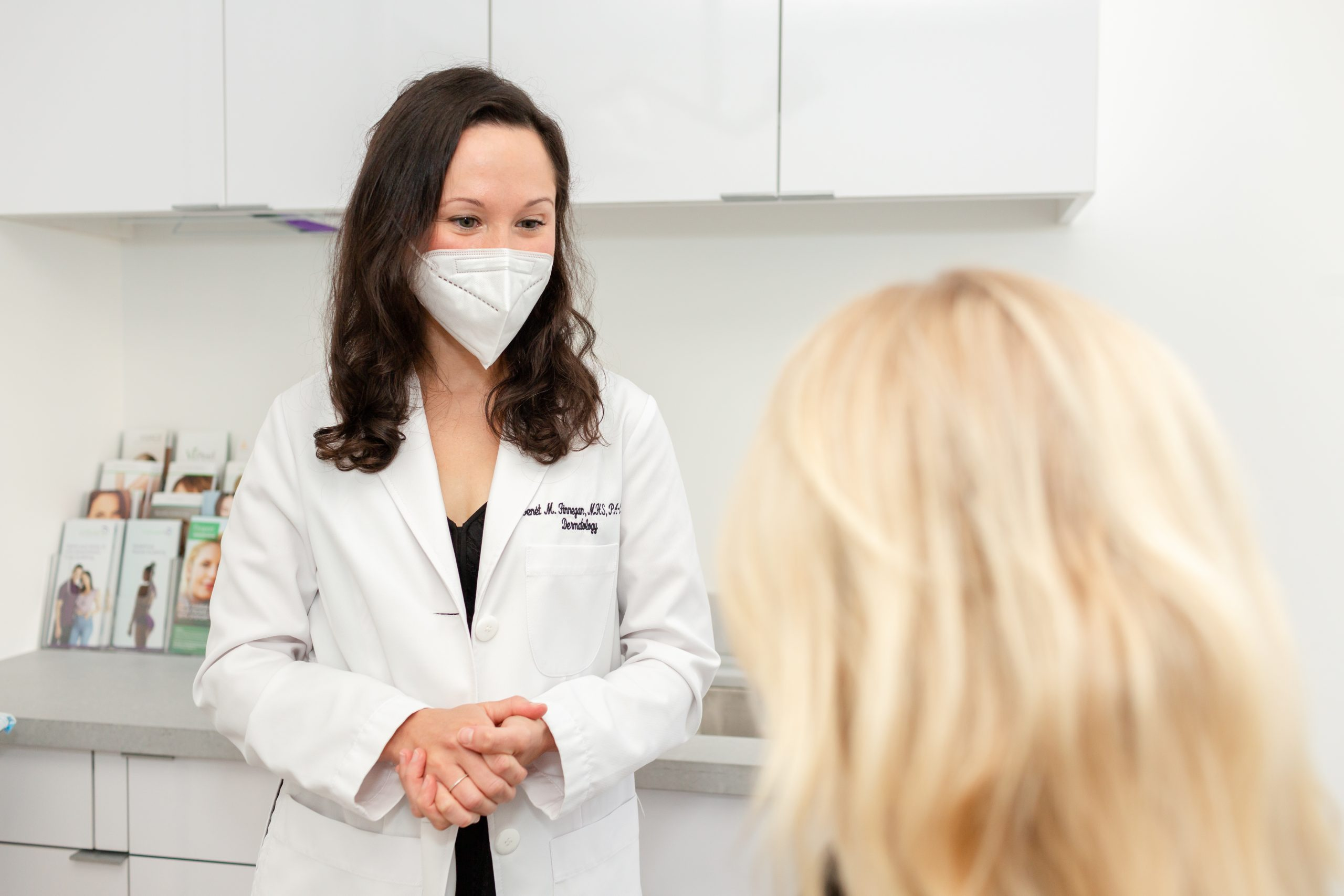 patient consulting with a dermatologist in NYC about how to limit the risk of skin cancer