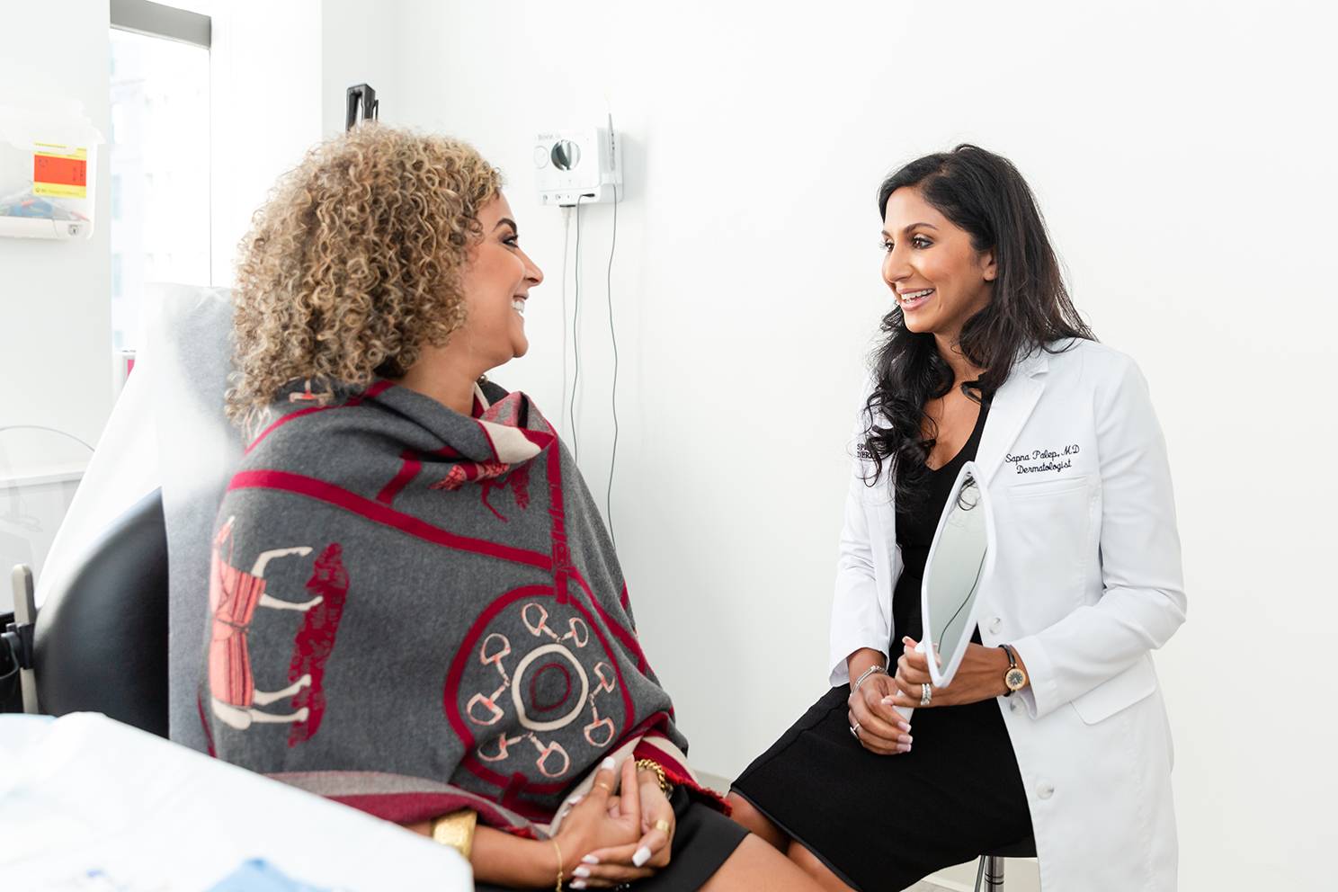 dermatologist consulting with a patient about Secret RF microneedling, a non-invasive wrinkle treatment in NYC