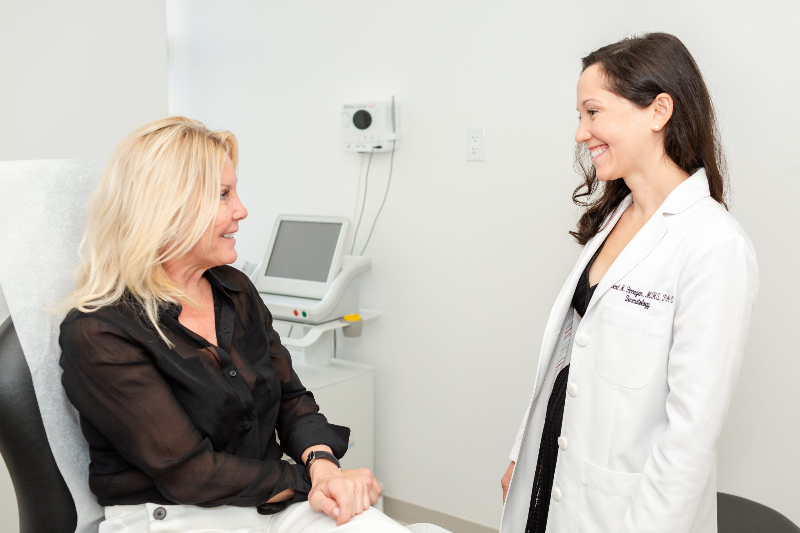 Dr. Genét Finnegan is consulting a female patient, Spring Street Dermatology, New York City, NY.